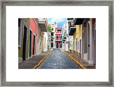 Old San Juan Alley Framed Print by John Rizzuto