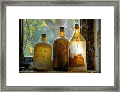 Old And Dusty Glass Bottles Framed Print