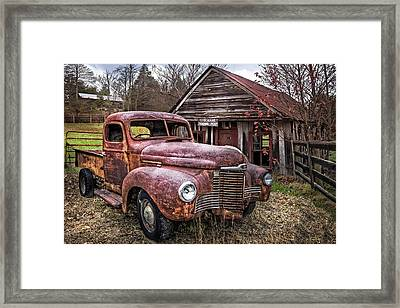 Old And Rusty Framed Print by Debra and Dave Vanderlaan