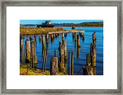 Old Boat And Pier Posts Framed Print by Garry Gay