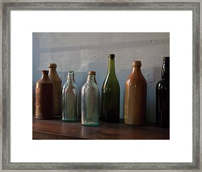 Old Bottles In North Light Framed Print by Michael Flood