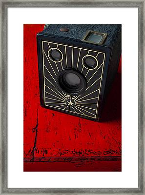 Old Camera On Red Table Framed Print