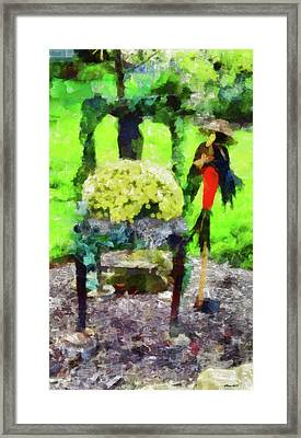 Old Chair Flowers And A Scarecrow Framed Print