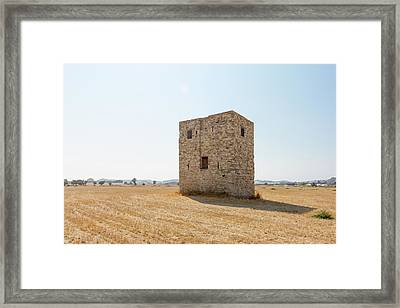 Old Cube-shaped Building In The Field Framed Print by Iordanis Pallikaras