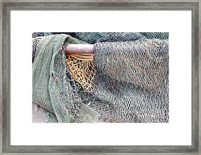 Framed Print featuring the photograph Old Discarded Fishing Nets by Yali Shi