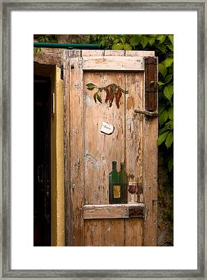 Old Door And Wine Framed Print
