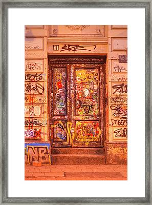 Old Door With Graffiti Framed Print
