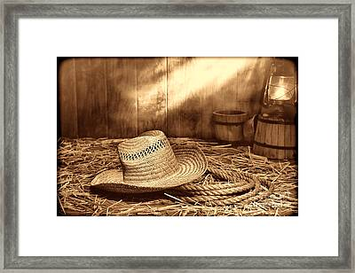 Old Farmer Hat And Rope Framed Print