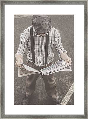 Old-fashioned Man Perusing The Latest Newspaper Framed Print