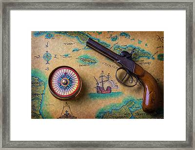 Old Gun And Compass On Map Framed Print