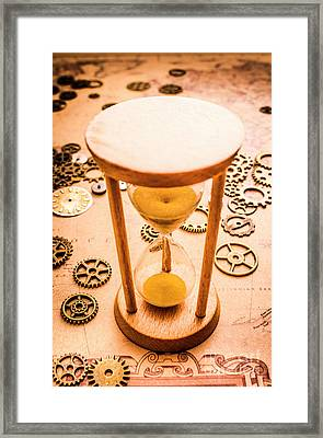 Old Hourglass Near Clock Gears On Old Map Framed Print