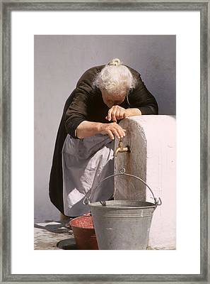 Old Lady With Water Pail Framed Print by Carl Purcell