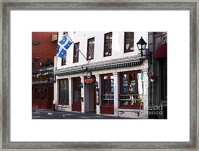 Old Montreal Storefront Framed Print by John Rizzuto