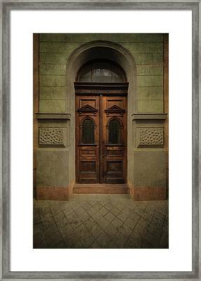 Old Ornamented Wooden Gate In Brown Tones Framed Print