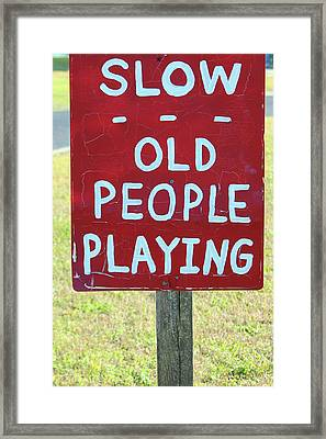 Old People Playing Framed Print by Cynthia Guinn
