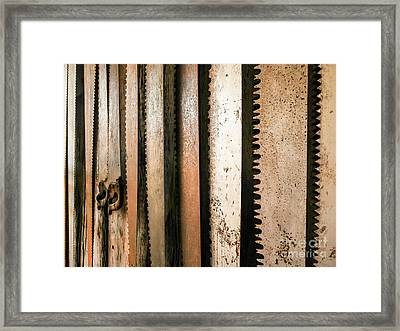 Retired Rusted Saws Framed Print by Lexa Harpell