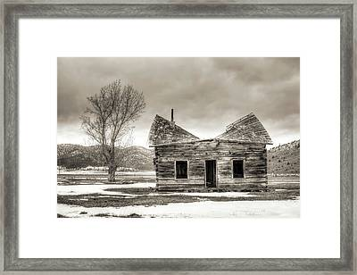 Old Rustic Log Cabin In The Snow Framed Print