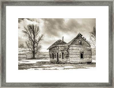 Old Rustic Log House In The Snow Framed Print