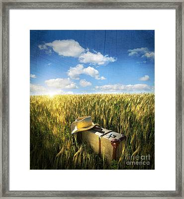 Old Suitcase With Straw Hat In Field Framed Print by Sandra Cunningham
