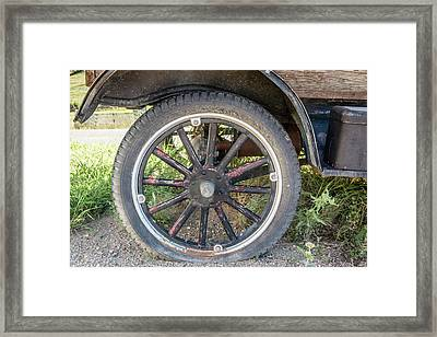 Old Truck Tire In Rural Rocky Mountain Town Framed Print by Peter Ciro