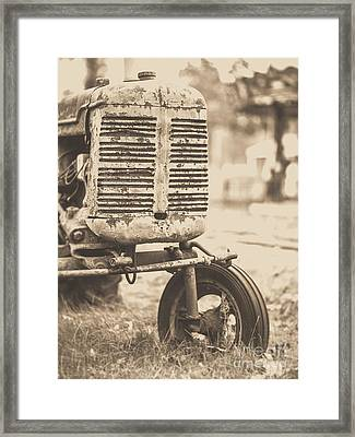 Framed Print featuring the photograph Old Vintage Tractor Brown Toned by Edward Fielding