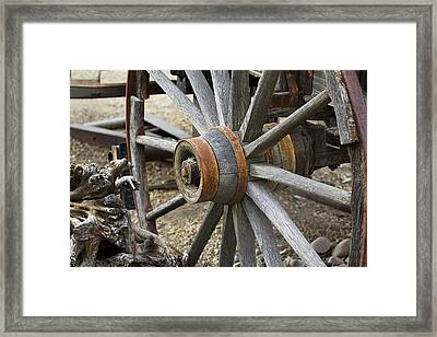 Framed Print featuring the photograph Old Waagon Wheel by Phyllis Denton