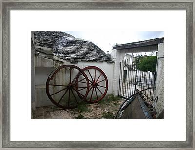 Old Wagon Wheels Framed Print by Dennis Curry