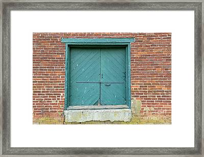 Old Warehouse Loading Door And Brick Wall Framed Print