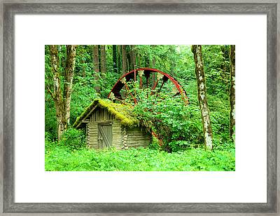 Old Wheel And Cabin Framed Print