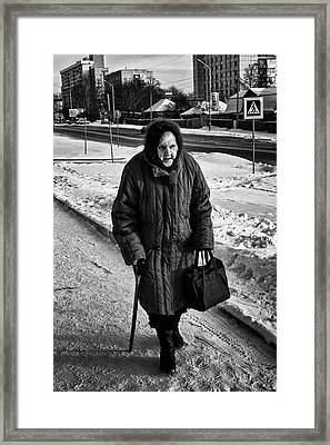 Old Woman And The Snow Framed Print