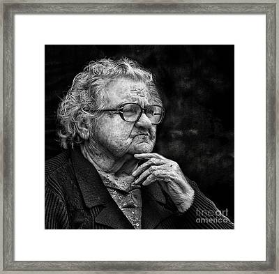 Old Woman Lost In Thought Framed Print by Stephan Grixti