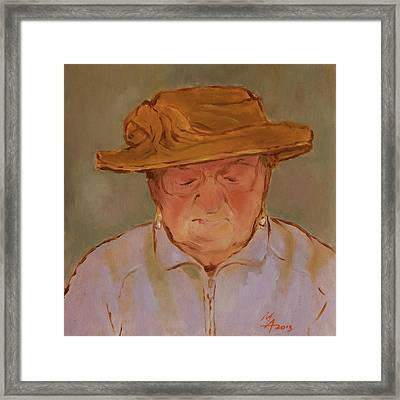 Old Woman With Yellow Hat Framed Print