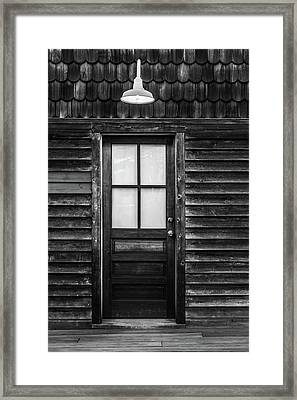 Framed Print featuring the photograph Old Wood Door And Light Black And White by Terry DeLuco