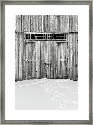 Old Wooden Barn Doors In The Snow Framed Print