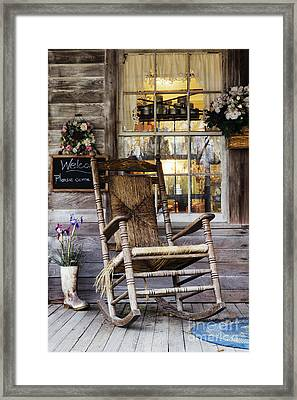 Old Wooden Rocking Chair On A Wooden Porch Framed Print by Jeremy Woodhouse