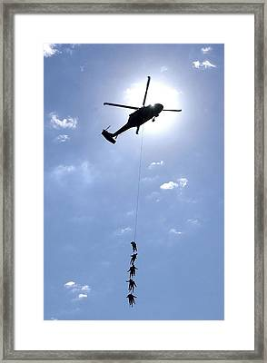 Oldiers And Airmen Hang 100 Feet Framed Print by Stocktrek Images