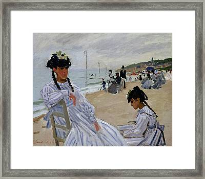 On The Beach At Trouville Framed Print by Claude Monet