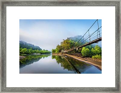 On The Edge Of The Dam Framed Print by Debra and Dave Vanderlaan
