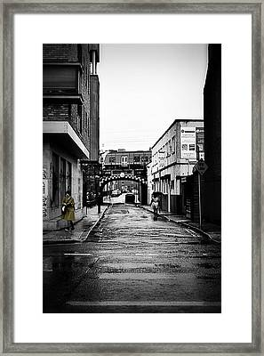 The Rail And The Green Raincoat Framed Print