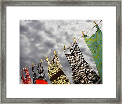 On The Line Framed Print by Rebecca Cozart