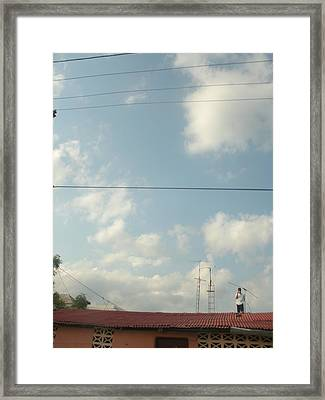 On The Roof Framed Print by Amy Andujar