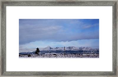 On The Snowy Road Framed Print