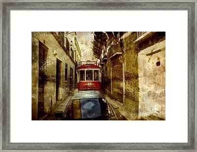 On The Streets Of Lisbon Framed Print by Dariusz Gudowicz