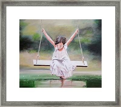 On The Swing Framed Print by Jamie Melton