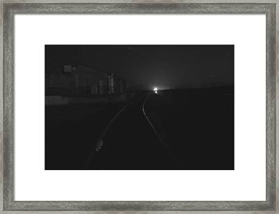On The Tracks At Night Framed Print