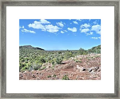 On Top A Mountain Framed Print by Debbie Wells