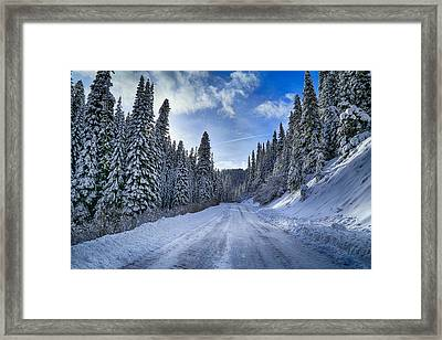 Snowy On Top Of The Hill Framed Print by Lynn Hopwood