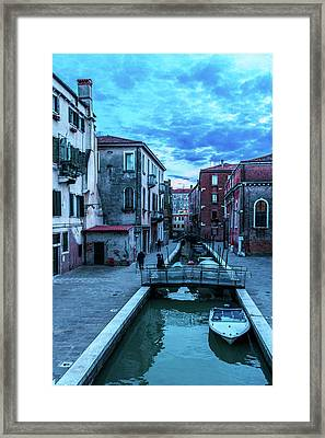 one of many normal channels of Venice on a summer evening Framed Print