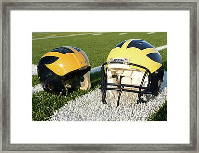One Old, One New Wolverine Helmets On The Field Framed Print
