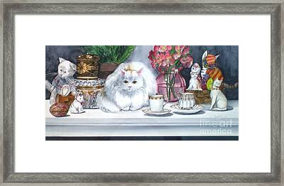 One Real Cat And Several Faux Kitties Framed Print